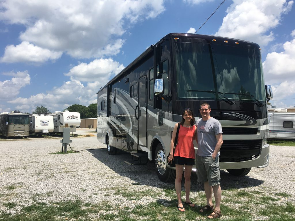 Kevin and Laura standing in front of their RV