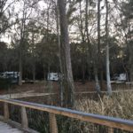 RVs parked along the lake at Three Rivers Campground.