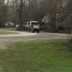 Golf cart driving by campsites at Palmetto Island State Park