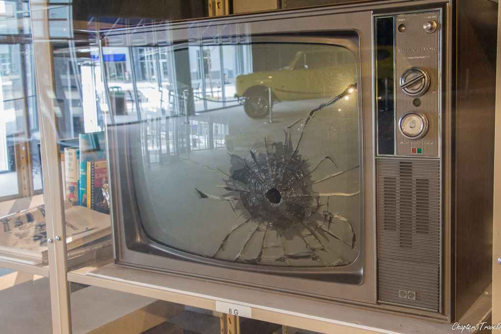 Television with bullet hole