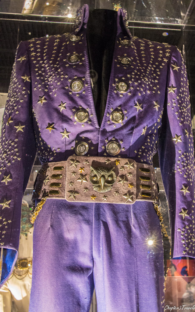 Purple jumpsuit with owl shaped belt