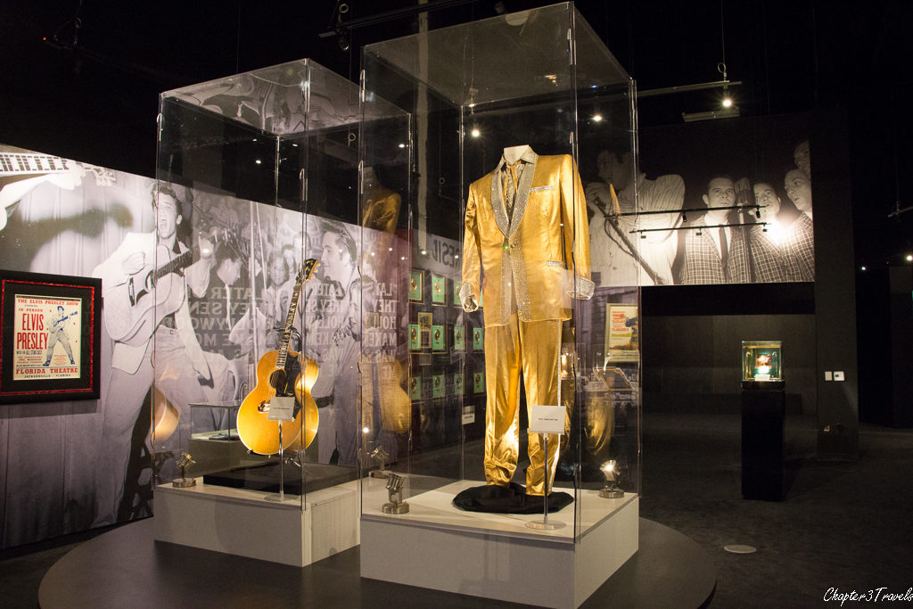 Gold suit and guitar