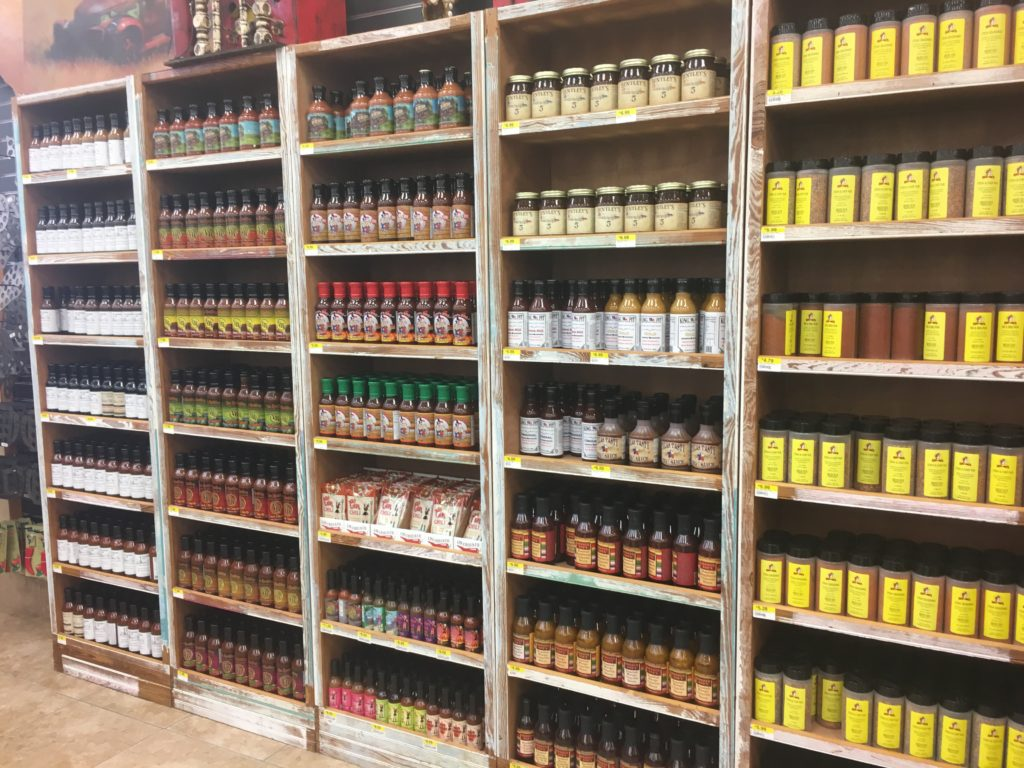 Shelves containing bottles of sauces and spices