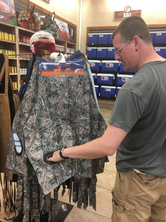 Kevin looking at an apron.