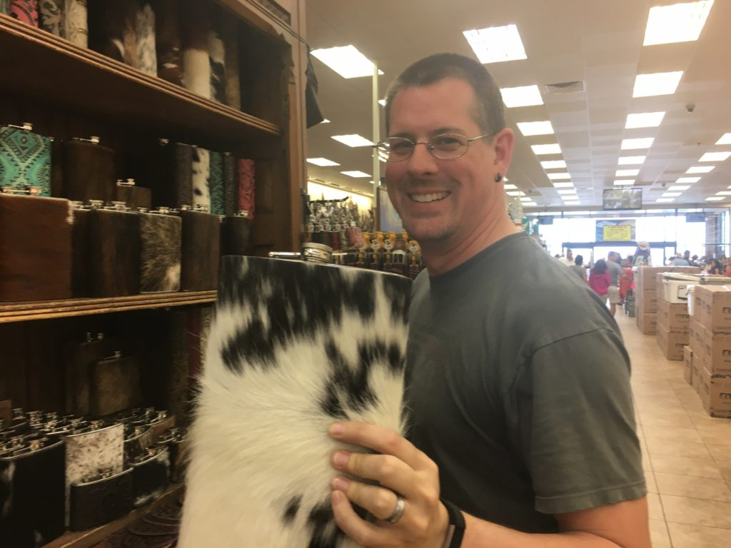 Kevin holding a fur covered flask