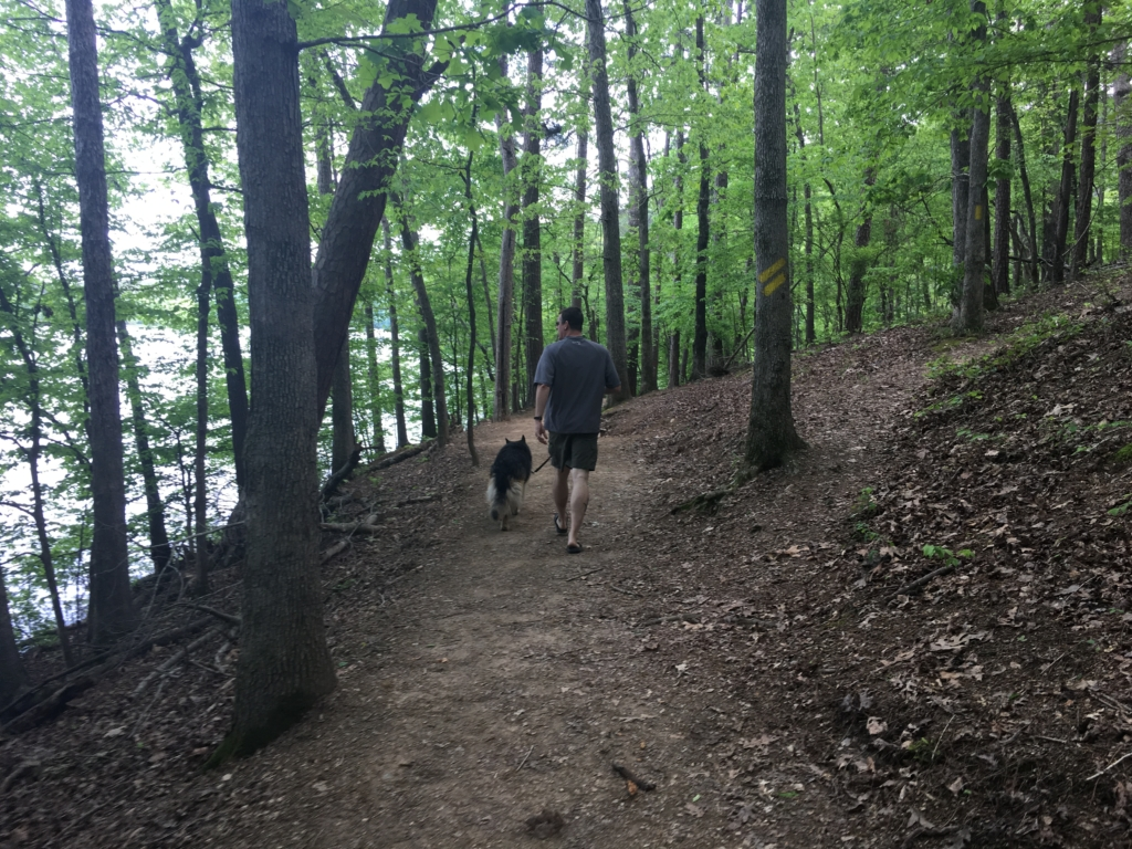 Kevin and Dixie walking a trail at Lake Catherine State Park.