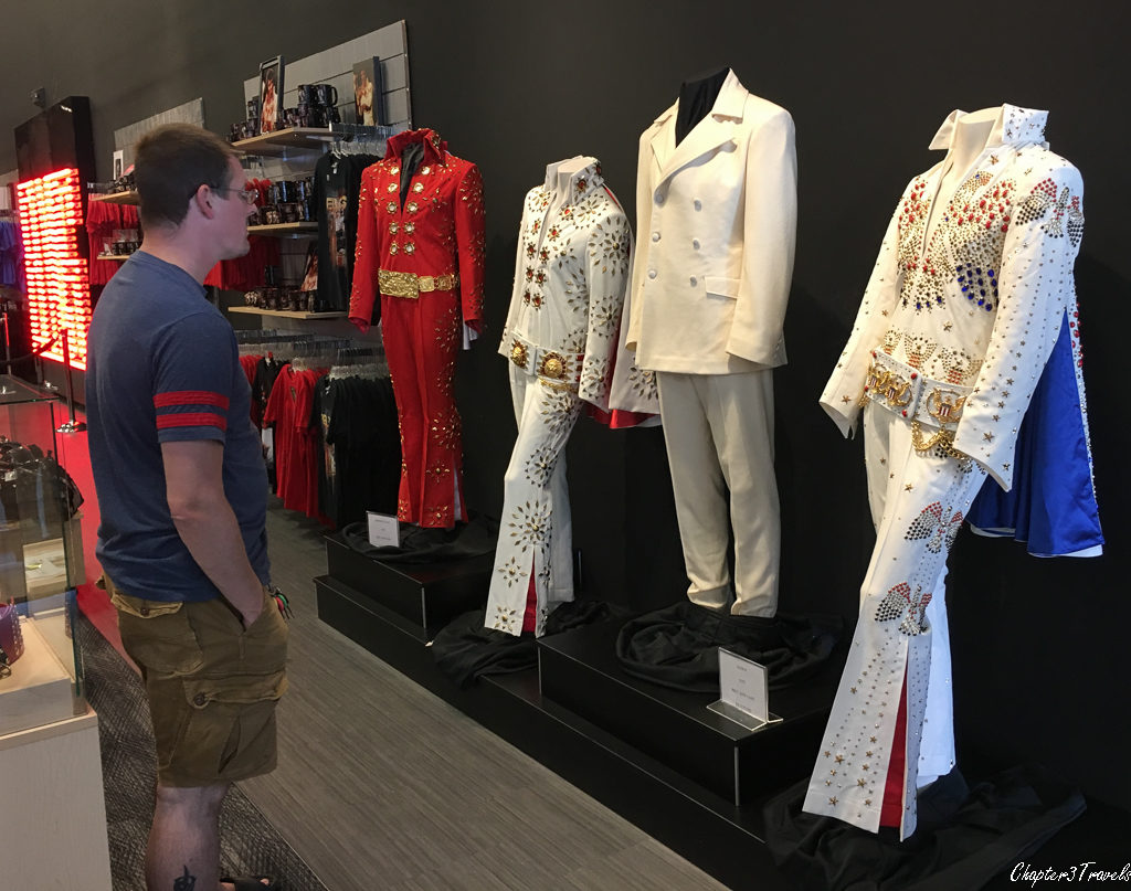 Kevin looking at display of costumes