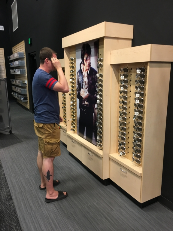 Kevin trying on sunglasses