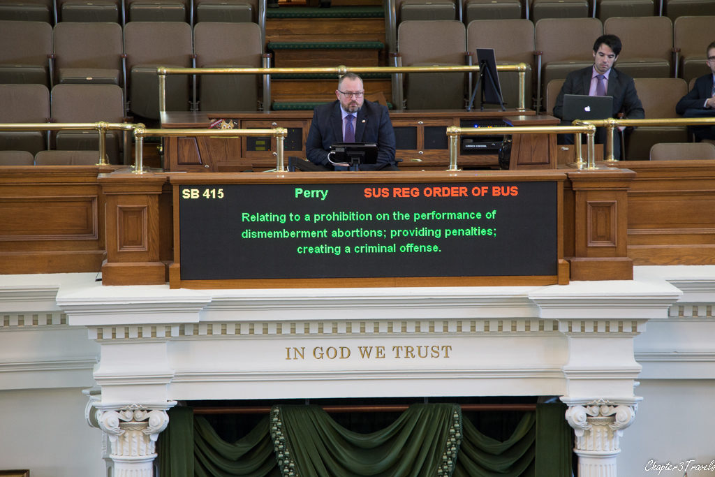 An electronic monitor showing a summary of an abortion rights bill in the Texas Senate.