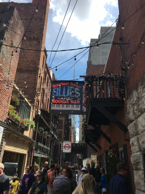 A busy alley featuring several music venues in downtown Nashville.