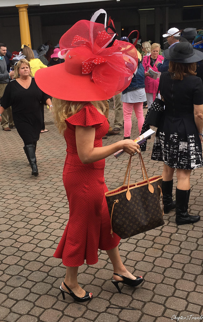 Woman wearing a very large ornate hat at the Kentucky Derby