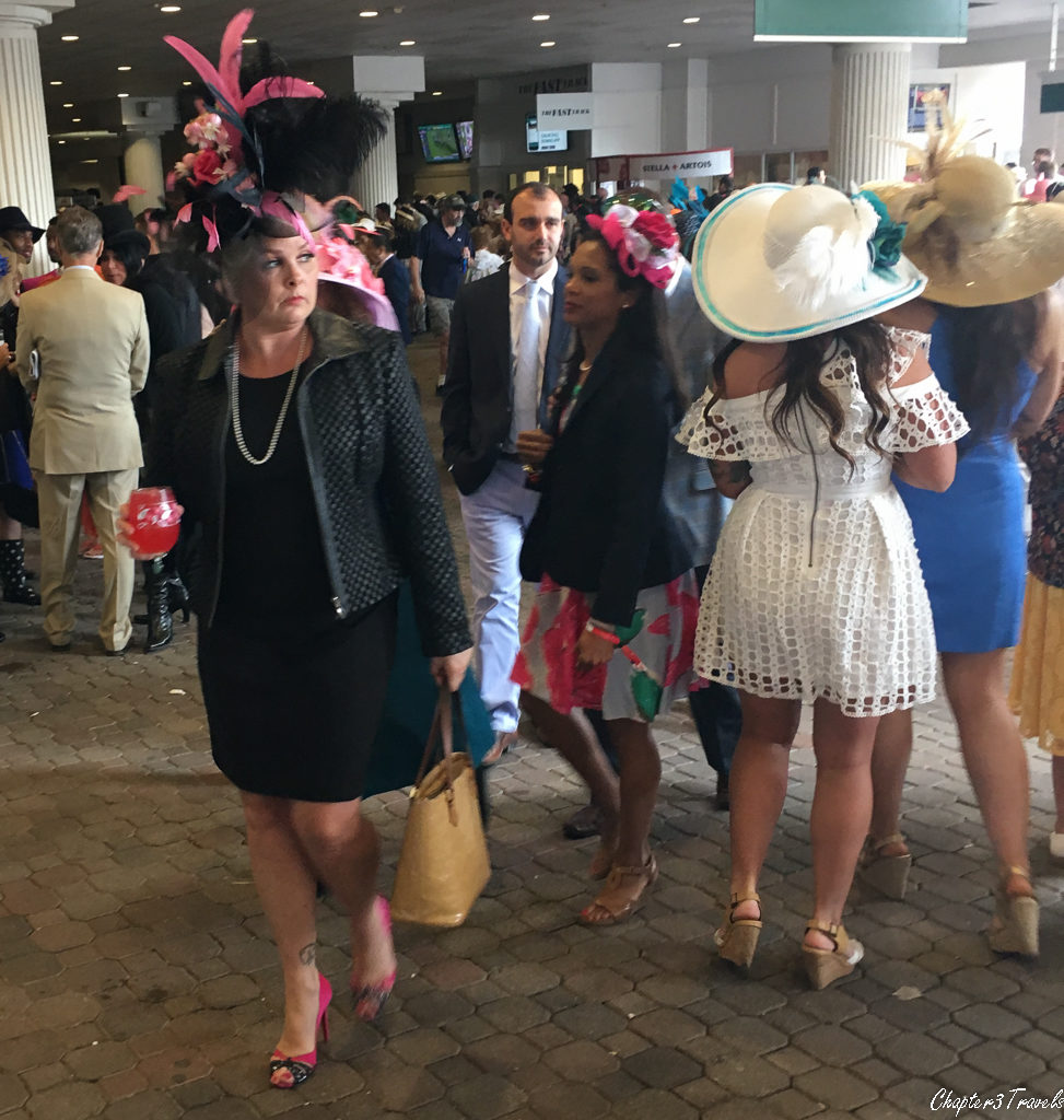 Woman wearing large, ornate hat at the Kentucky Derby