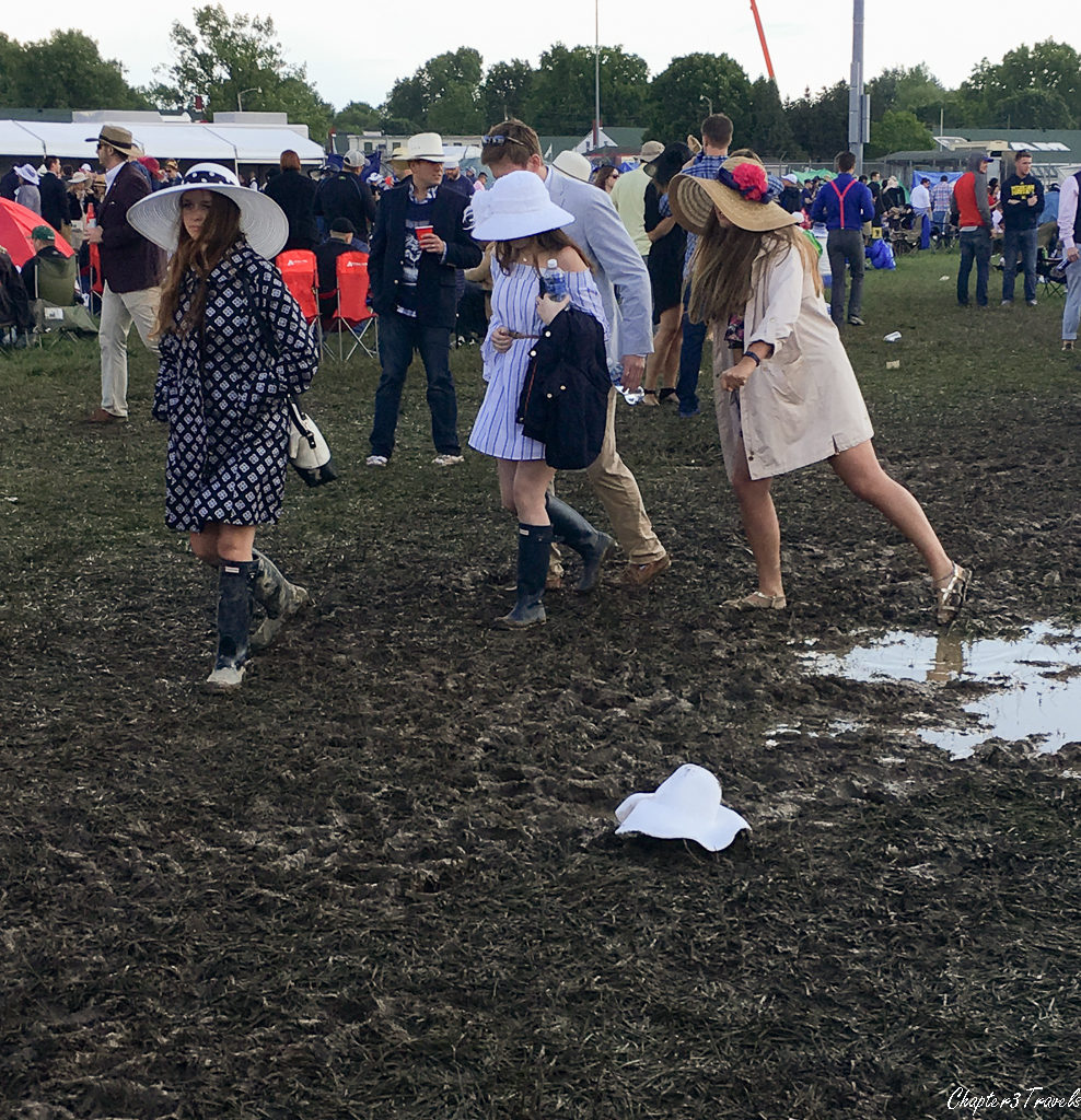 Women walking through a muddy area at the Kentucky Derby