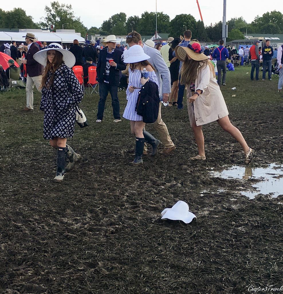 Women walking through a muddy area at the Kentucky Derby