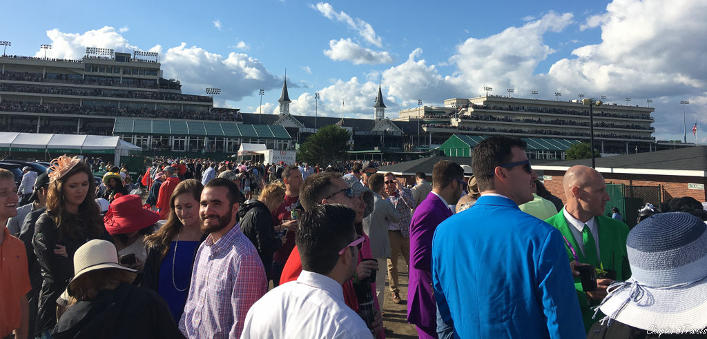 People standing in the infield at the Kentucky Derby