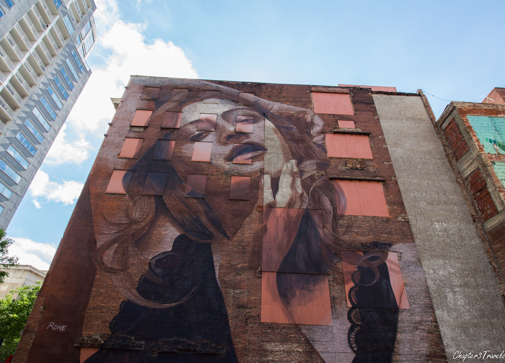 A large painting of a woman on the side of a building in Nashville, Tennessee.