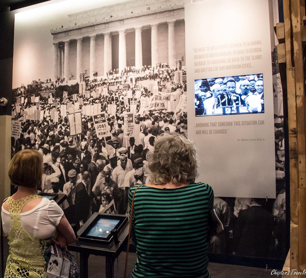 People watching video of MLK's speech in Washington