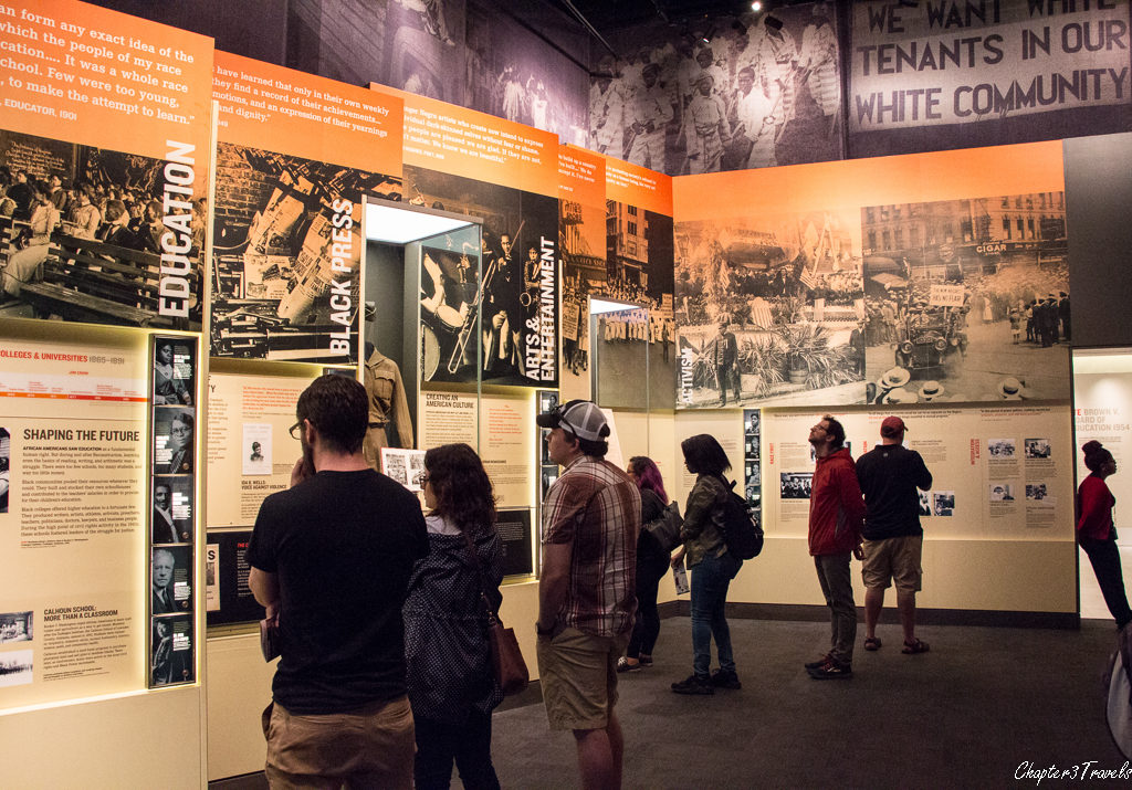 Visitors reading exhibit panels at the museum.