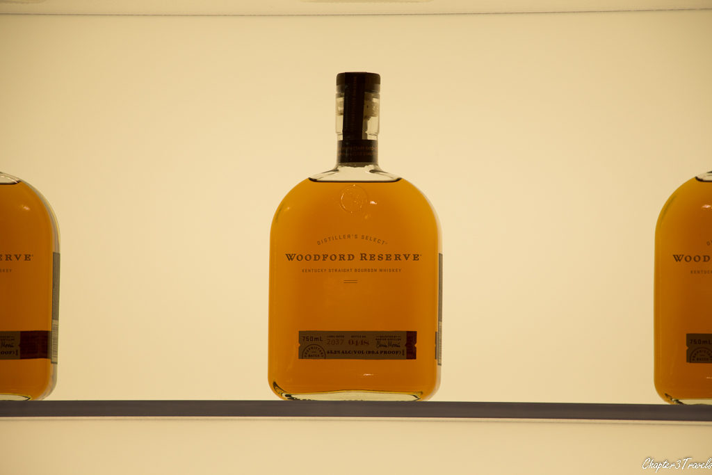 Bottles of Woodford Reserve illuminated from behind
