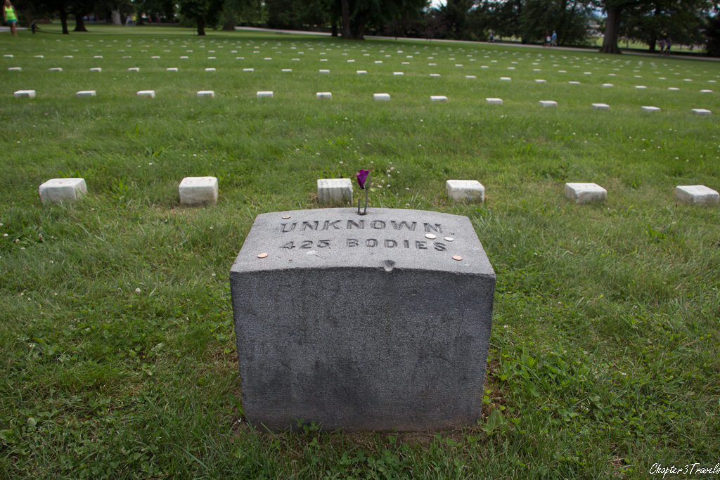 Plaque and grave markers at Soldiers National Cemetery in Gettysburg, Pennsylvania