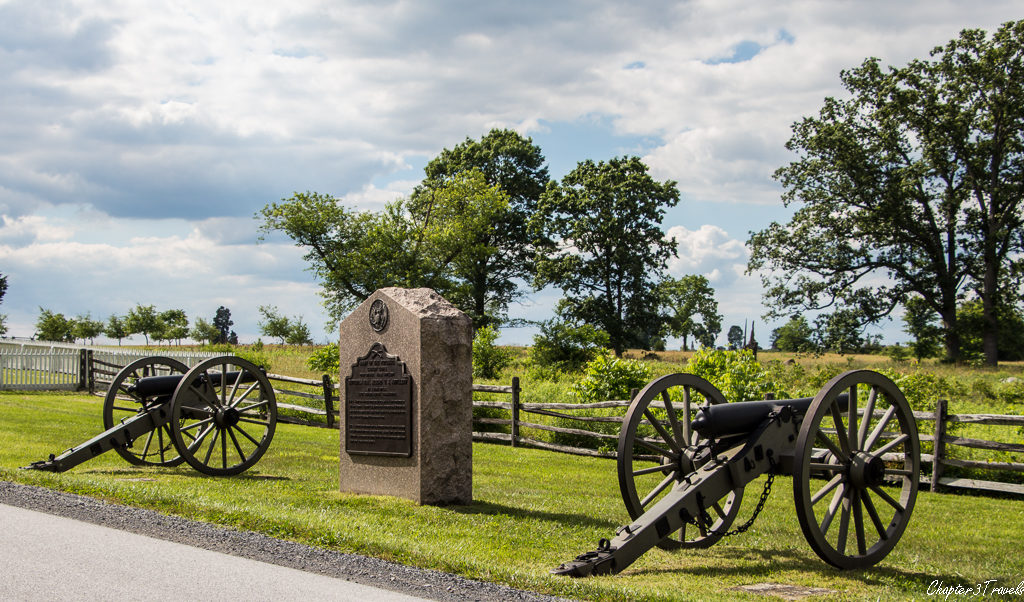 Two canon surrounding a monument at Gettysburg National Military Park in Gettysburg, Pennsylvania