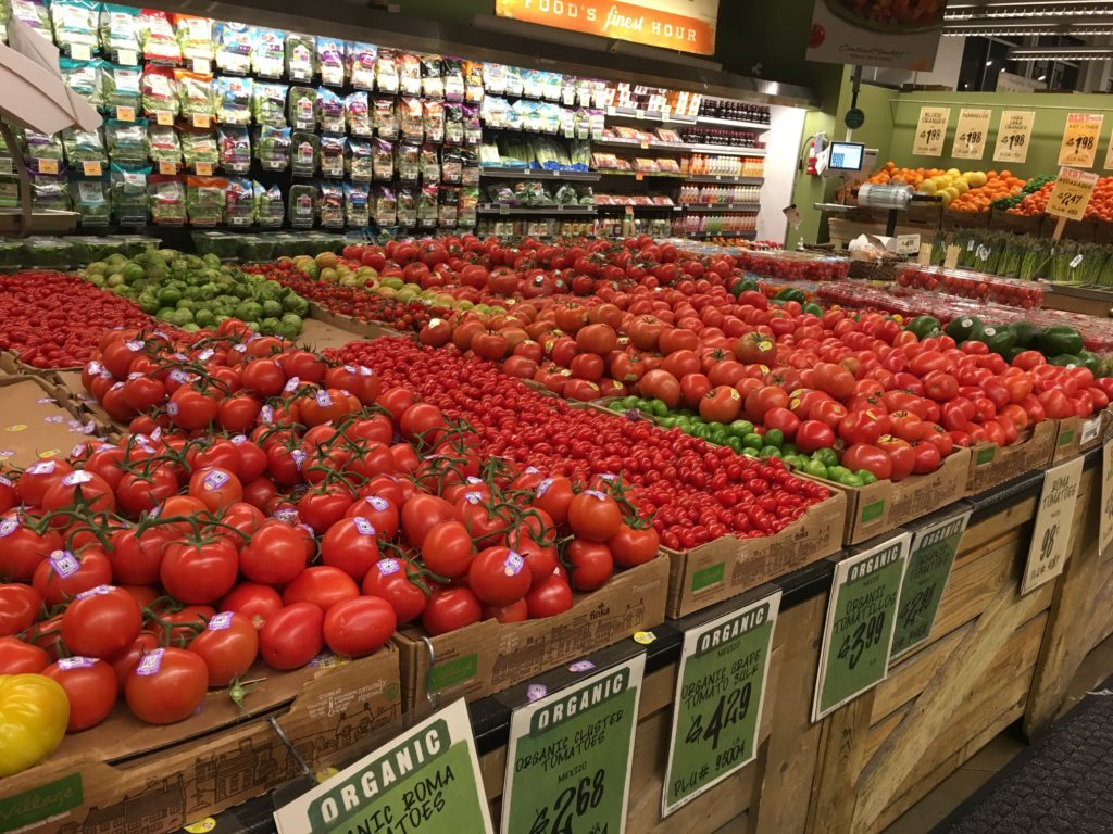 A grocery store display of tomatoes