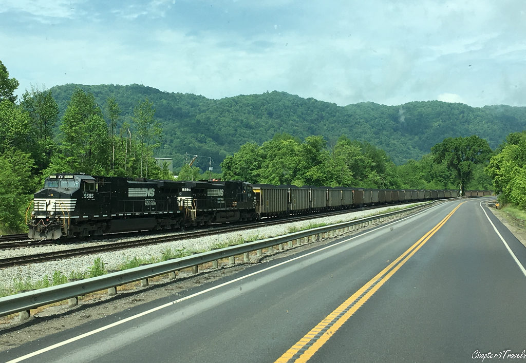 Coal train parked next to highway