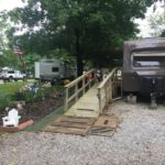 RV with ramp and landscaping