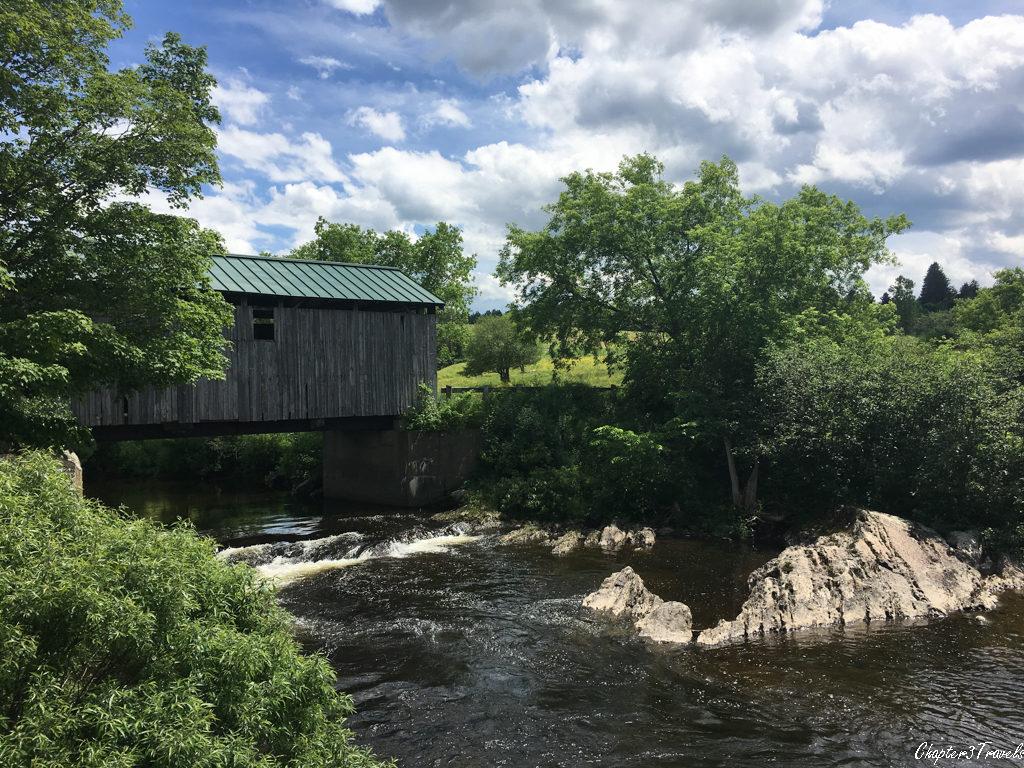 A covered bridge over a creek in Vermont