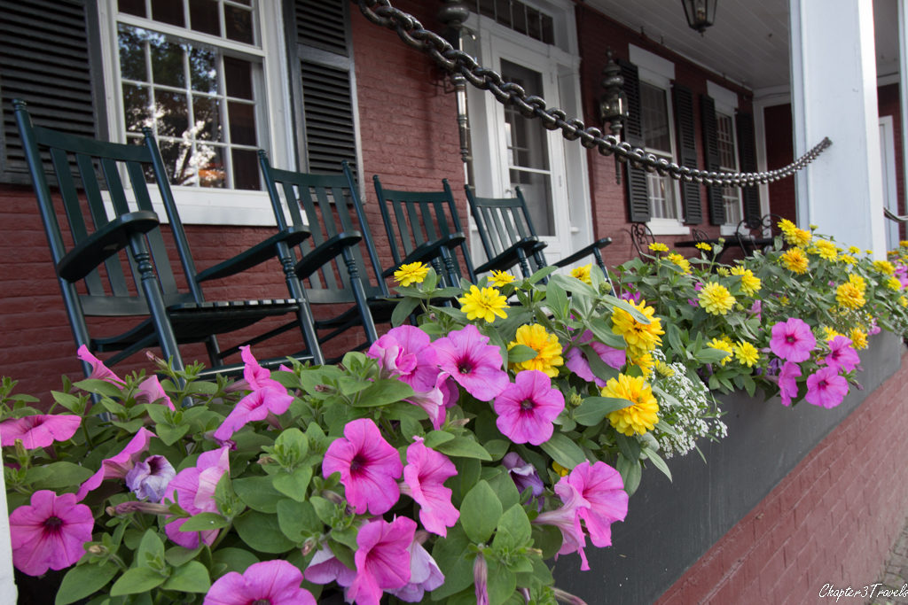 A front porch with rocking chairs and flowers in Stowe, Vermont