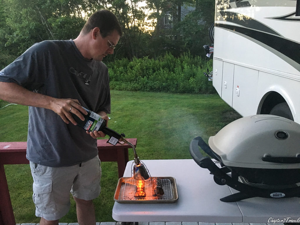 Kevin cooking lobster tails with a blowtorch