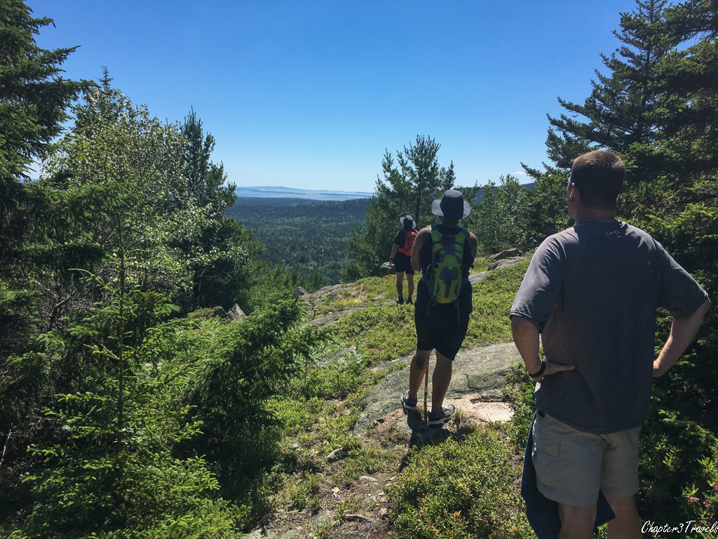 Melinda, Eryk, and Kevin looking out at the view from Beech Mountain Trail