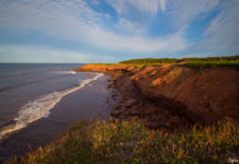 Beach and cliffs of Prince Edward Island at sunset
