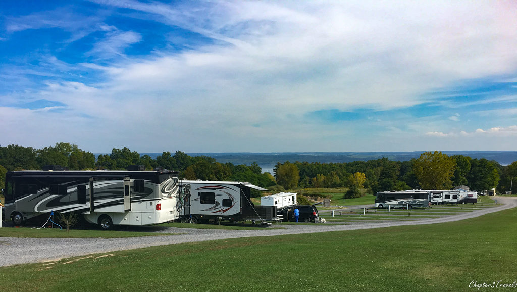 RVs parked parallel to one another at the top and bottom of a hill