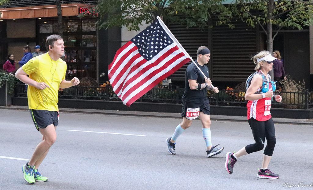 Chicago Marathon runner carrying American flag
