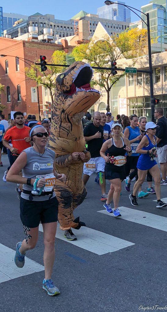 a runner in a T-Rex costume at the 2017 Chicago Marathon