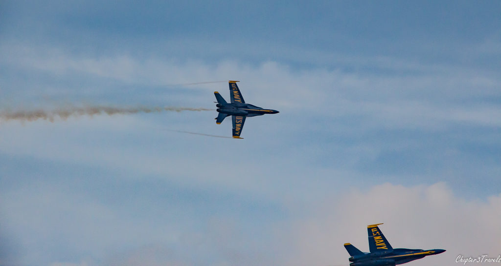 One and a half Blue Angels jets in frame of photo