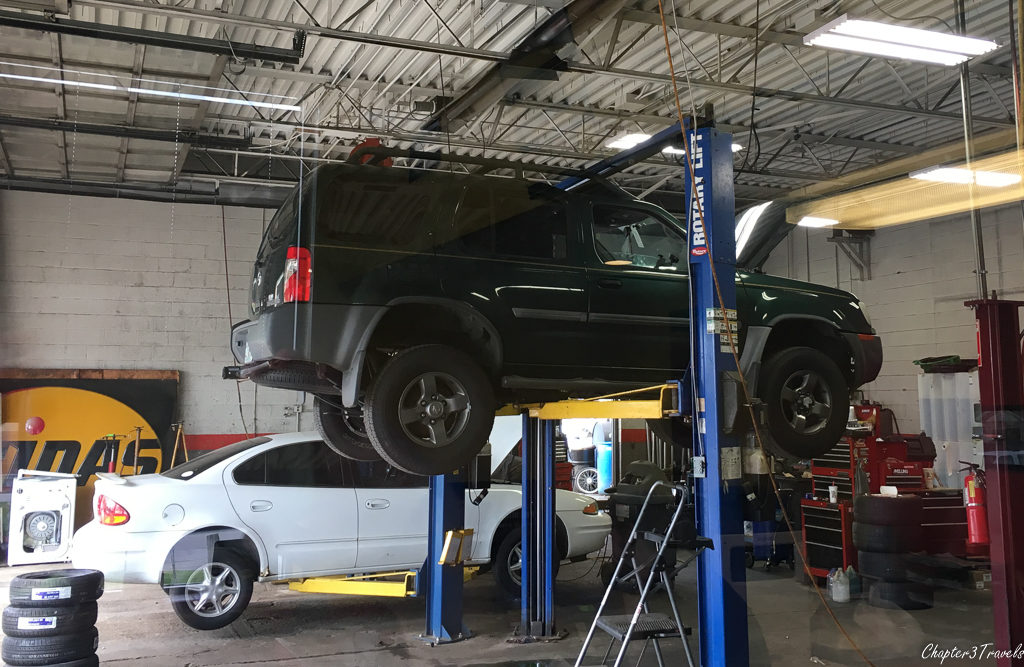 Nissan Xterra on car lift a Midas