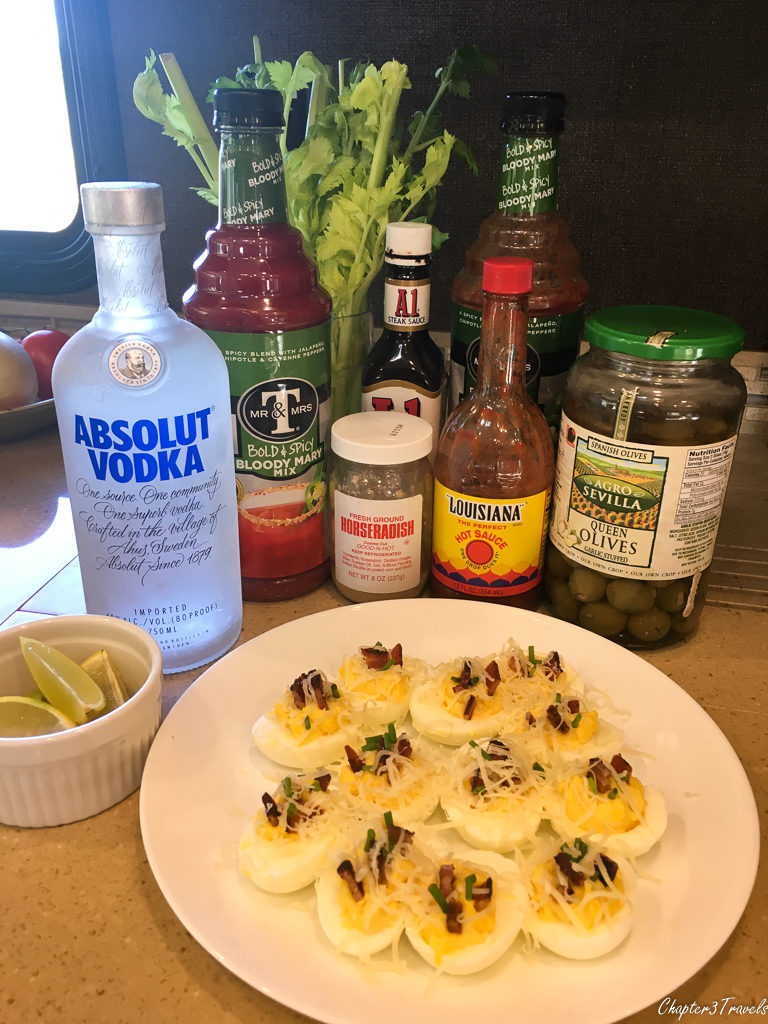 Blody Mary ingredients and a plate of deviled eggs