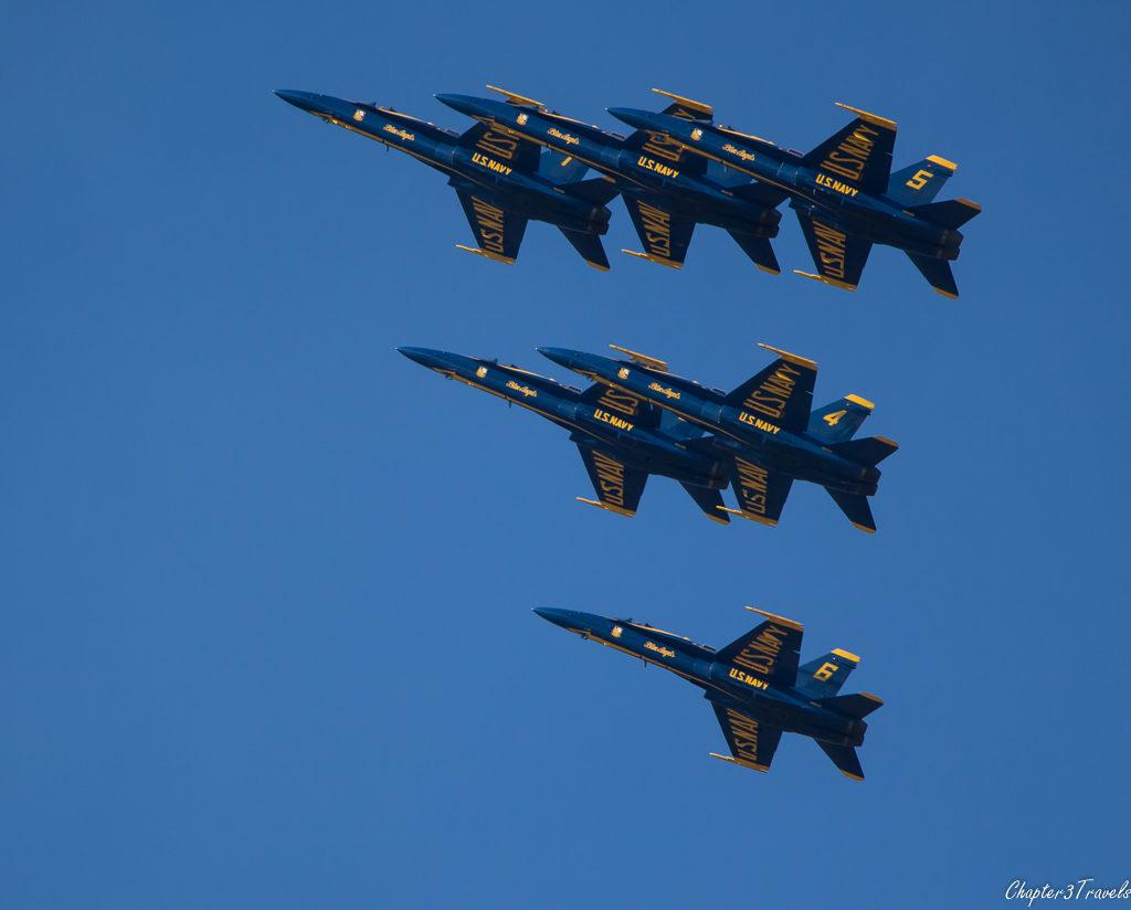 Six Blue Angel jets flying together