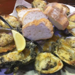 Chargrilled oysters at Acme Oyster House