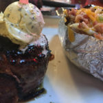 Bacon wrapped filet and loaded baked potato at Big Mike's Steakhouse