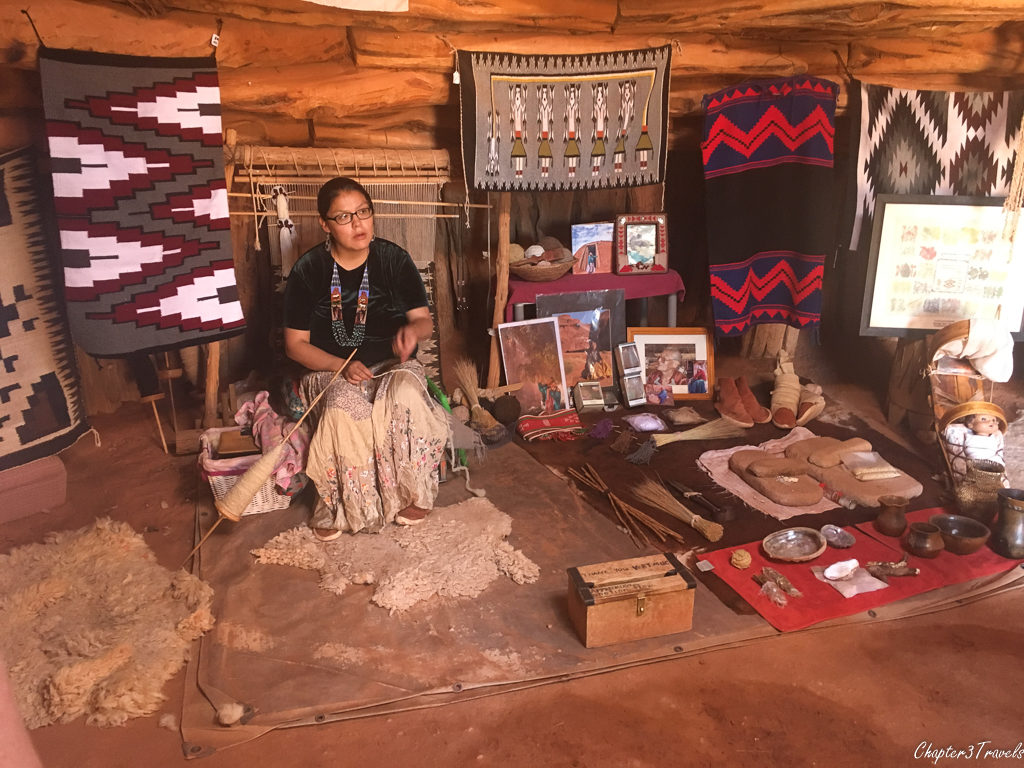 Rug making demonstration in Navajo hogan in Monument Valley