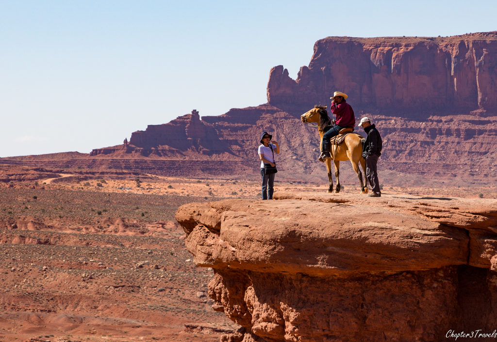 Horse and rider at John Ford Point in Monument Valley