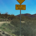 Sign saying no pavement for next 22 miles