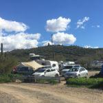 RVs, cars, and tarps at Black Canyon Campground