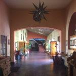Hallway with arched doorways inside La Posada Hotel