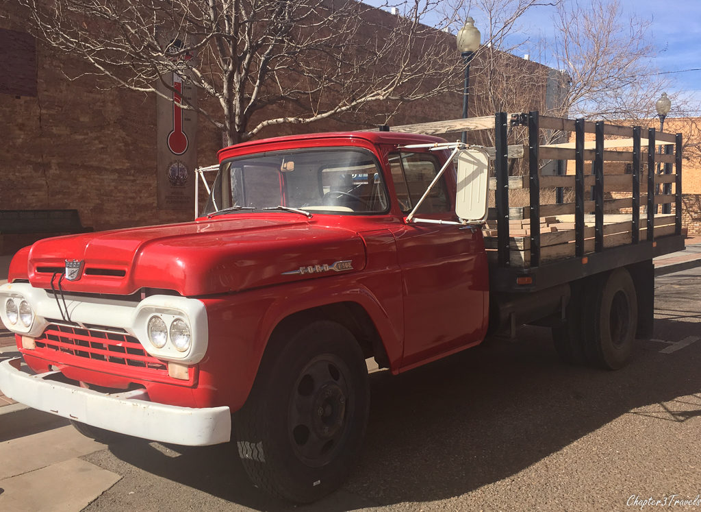 "Red flatbed Ford truck at ""Standin on the Corner Park"" in Winslow, Arizona"