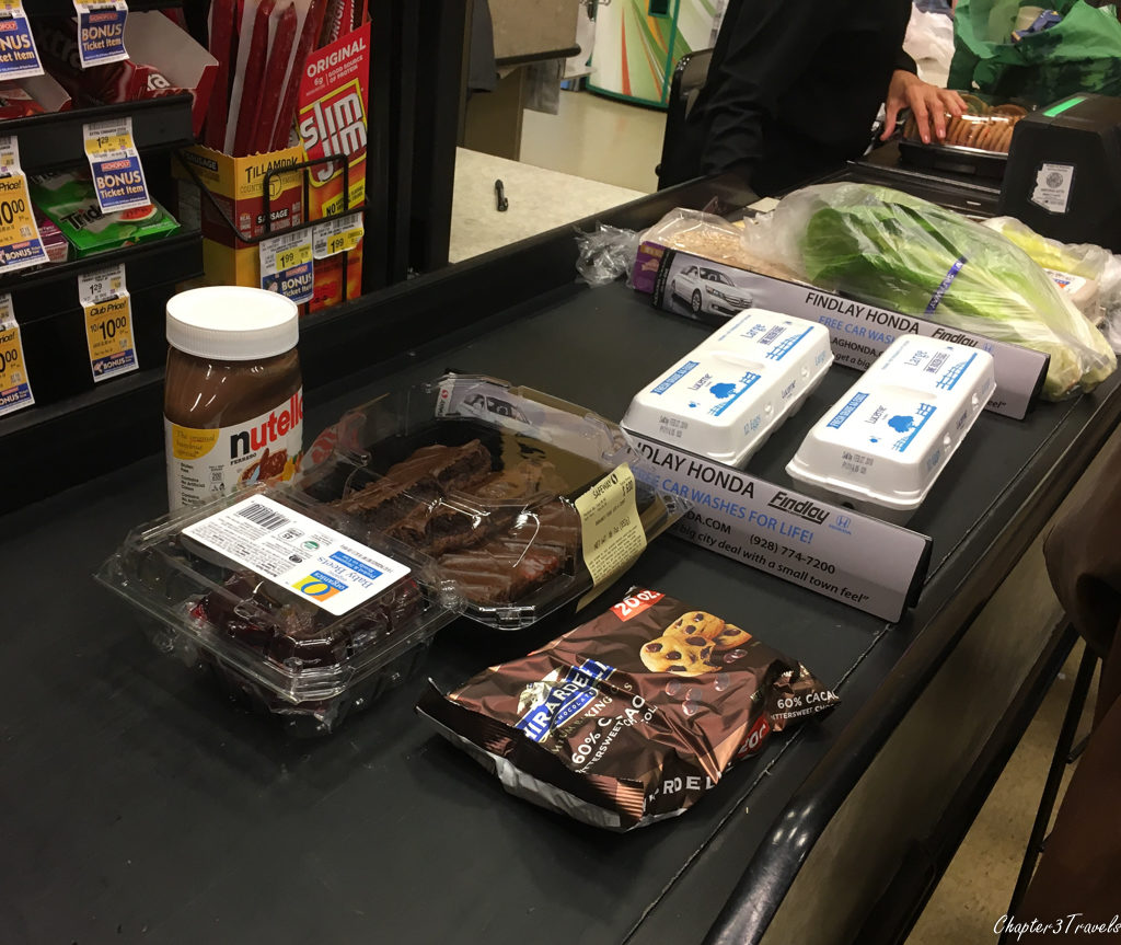 Nutella, Chocolate frosted brownies, chocolate chips, and beets at grocery store