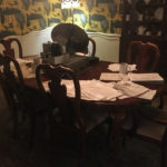 Dining room table covered in papers